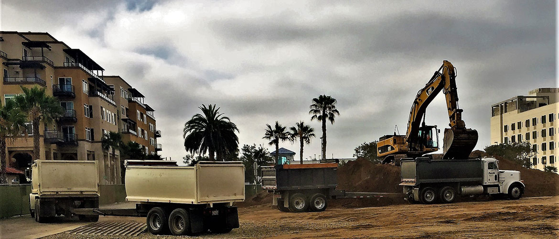 trucks on dirt road